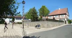 Gemeinde-Allianz Hofheimer Land: Neugestaltung des Bereichs um das ehemalige Pfarrhaus Mechenried (Bildmontage)
